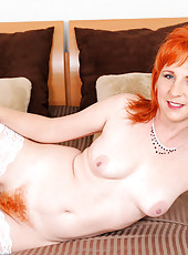 Lovely Sasha Brand takes off her sexy lingerie and tortures her hairy milf pussy with a dildo
