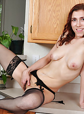 Classy cougar Amanda wets her hairy pussy in the kitchen sink