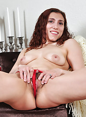 Anilos redhead Amanda grabs her breasts as she spreads her hairy pussy