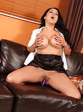 Anilos Kiara Mia pops out her huge mature tits while masturbating with a purple dildo