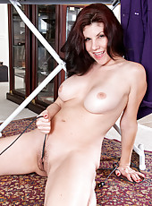 Milf next door gives her hairy pussy a cameltoe with an iron cord
