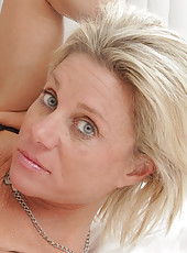 Blonde amateur milf slips off her thong to finger her pussy