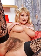 Milf Vanessa Sweets pleasures her hairy bush pussy wearing stockings
