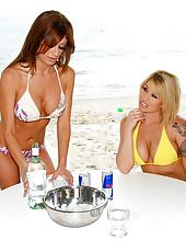 Sexy beach booty lesbian milfs fuck their bikini pussies in these hot dildo fucking pics