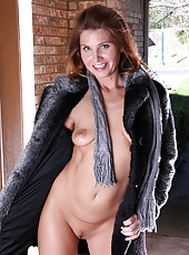 39 year old redhead Sky Rodgers shows up wearing nothing but mink