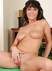 Tight and horny MILF Coral stuffing a couple fingers into her snatch