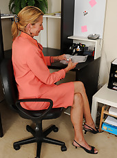 Skinny 56 year old Pam takes a break from her office work to spread