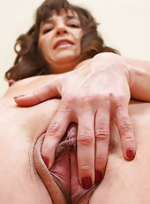 Beautiful brunette Suzie showing off her tight naked 47 year old body