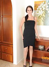 Elegant brunette Hailey Murphy slips out of her black evening gown