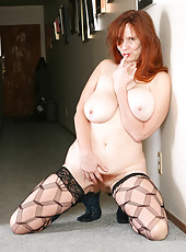Redheaded MILF Breeze from AllOver30 showing off her natural pussy