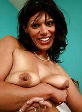 Exotic and hairy MILF Issabella disrobes and spreads her dark legs