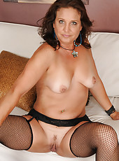 Brunette MILF Chane shows off her sexy pussy frames by blue lingerie
