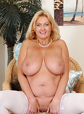 Busty MILF Tahnee Taylor from AllOver30 in white stockings spreads