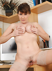 Hot 47 year old Alexandra Silk spreads her trimmed pussy at work