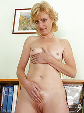 New mature model Leny from AllOver30 strips and tugs at her pussy
