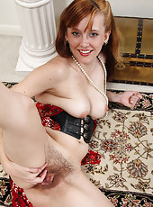 Readheaded MILF with a hairy pussy looking elegant and sexy