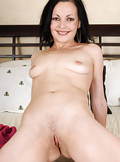 Petite brunette MILF Claudia K making her lingerie look hot and sexy