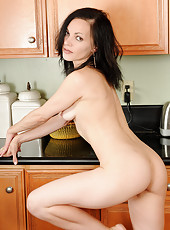 Petite housewife Claudia K from AllOver30 spreads wide in the kitchen
