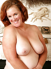 Big and busty Lucy A strips and spreads her hot and hairy beaver