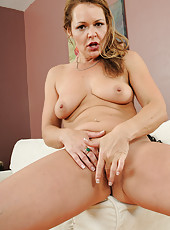 Sexy 43 year old office chick Kelly stabs her pussy with a fingertip