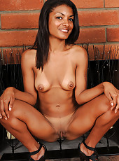 Exotic and lacey Neela flaunts her tight dark body in the livingroom