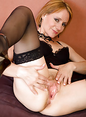 46 year old blonde Tiffany slips a couple fingers into her mature pussy