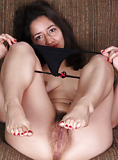 Hairy pussied Miranda probes her furry pussy with her glass toy