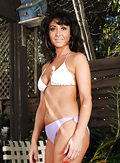 Horny brunette MILF Coral strips and spreeads her ass on the deck