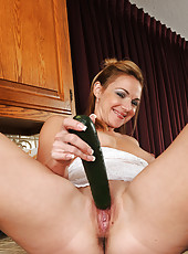 31 year old Samantha Rae slips a ripe cucumber into her shaver box