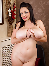 Busty brunette Michelle B stuffs her 30 year old pussy with plastic