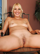 Hot blonde MILF Andi slips off her red panties and spreads her pussy