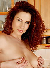 32 year old Yvete shows off her incredible mature body in her kitchen