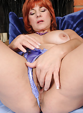 At 52 years old gorgeous redheaded Calliste looks great in her lingerie