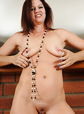 Sexy and elegant Xena wearing long beads and nothing else looks great