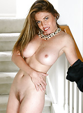 Hot MILF Kacey plays with her trimmed and tidy mature pussy here