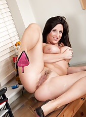 Busty brunette gets bored in the office and decides to play