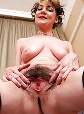 Lacy 42 year old Eszti from AllOver30 spreads her hairy snatch here