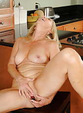 55 year old Annabelle from AllOver30 enjoying her large red vibrator