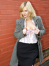 Hot blonde MILF Laurita strolls and flashes pussy on the city streets