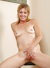 Mature blonde shows off her very hairy pussy in this series of pics