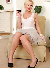 Tight bodied MILF Anna Joy sips wine and then strips naked for you