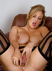 Busty blonde Jenny Badeau stuffs her mature pussy with her vibrator