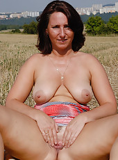 Natural titted Demi from AllOver30 plays nudist out in the farmers field