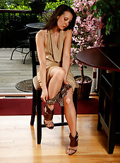34 year old Lily slips off her elegant dress and shows off her body