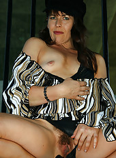 Hard body Andie from AllOver30 showing off her hairy pussy outdoors