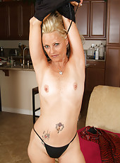 Cute blonde 47 year old strips off her red latex for these pictures