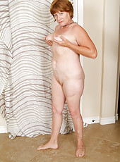 Playful 47 year old MILF spreads her mature legs for the camera