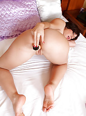 Tight pussied Eloa strips off her lingerie and stabs her pussy with dildo