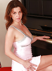 36 year old Patris showing off her large mature pussy while on the piano