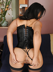 Exotic 33 year old Anita Peida slides out of her sexy black lingerie